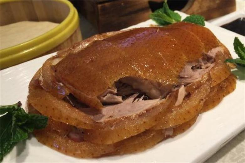 四季民福烤鸭店加盟